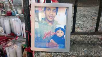 The shooting victim and his 5-month-old son.