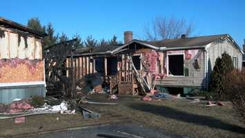A woman in her 70s and two relatives staying with her were alerted by a smoke detector.