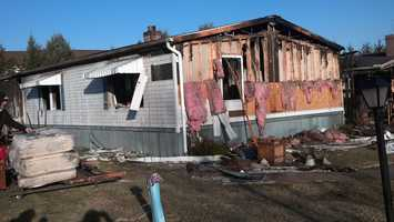 Wiring behind the refrigerator in the first home sparked the fire.