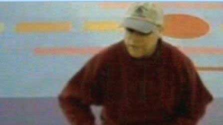 Police released this surveillance photo of the man accused in the bank robbery.