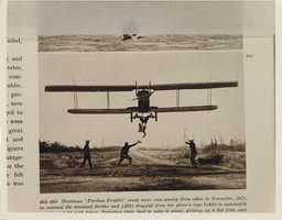 """Pilots would also fly very close to the ground to perform other stunts. Here""""Fearless Freddie"""" prepares to grab a hat while hanging upside down from the plane."""
