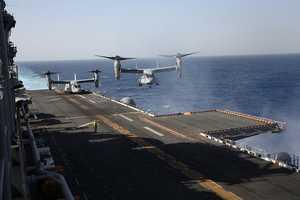 An MV-22 Osprey lands aboard USS Kearsarge at sea.