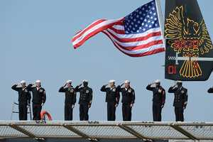 Sailors assigned to the amphibious transport dock ship USS Arlington (LPD 24) man the rails and bring the ship to life during its commissioning ceremony. Arlington was named for Arlington County, Va., and honors first responders and the 184 victims of the Sept. 11, 2001 terrorist attack on the Pentagon.