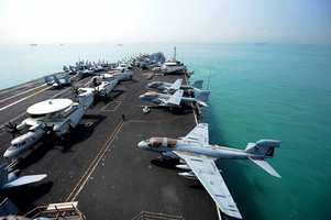 The Nimitz-class aircraft carrier USS John C. Stennis (CVN 74) gets underway. John C. Stennis is deployed to the U.S. 7th Fleet area of responsibility conducting maritime security operations, theater security cooperation efforts.