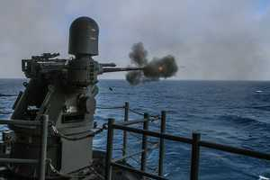 A MK38 25 mm machine gun fires remotely during a live-fire exercise aboard the amphibious assault ship USS Boxer (LHD 4).