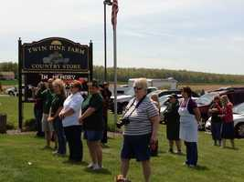 Mourners line the funeral procession route.