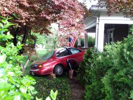 A woman suffered a minor head injury Wednesday morning when her car crashed into the porch of an Elizabethtown home.