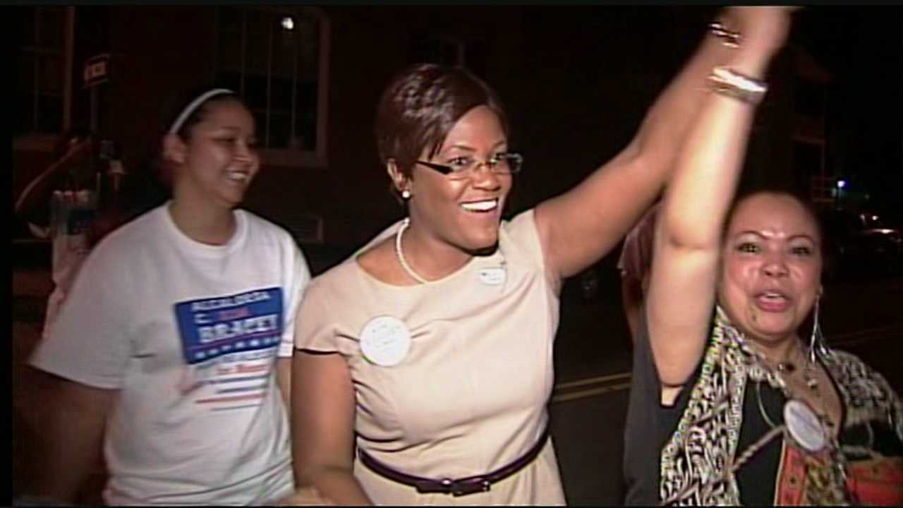 Incumbent Mayor Kim Bracey raises her hand high after winning her primary race in the city of York.