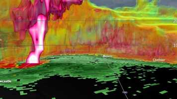 This is a 3D look at the Moore tornado using the new dual polarization radar. The white-colored tube is a hail shaft.