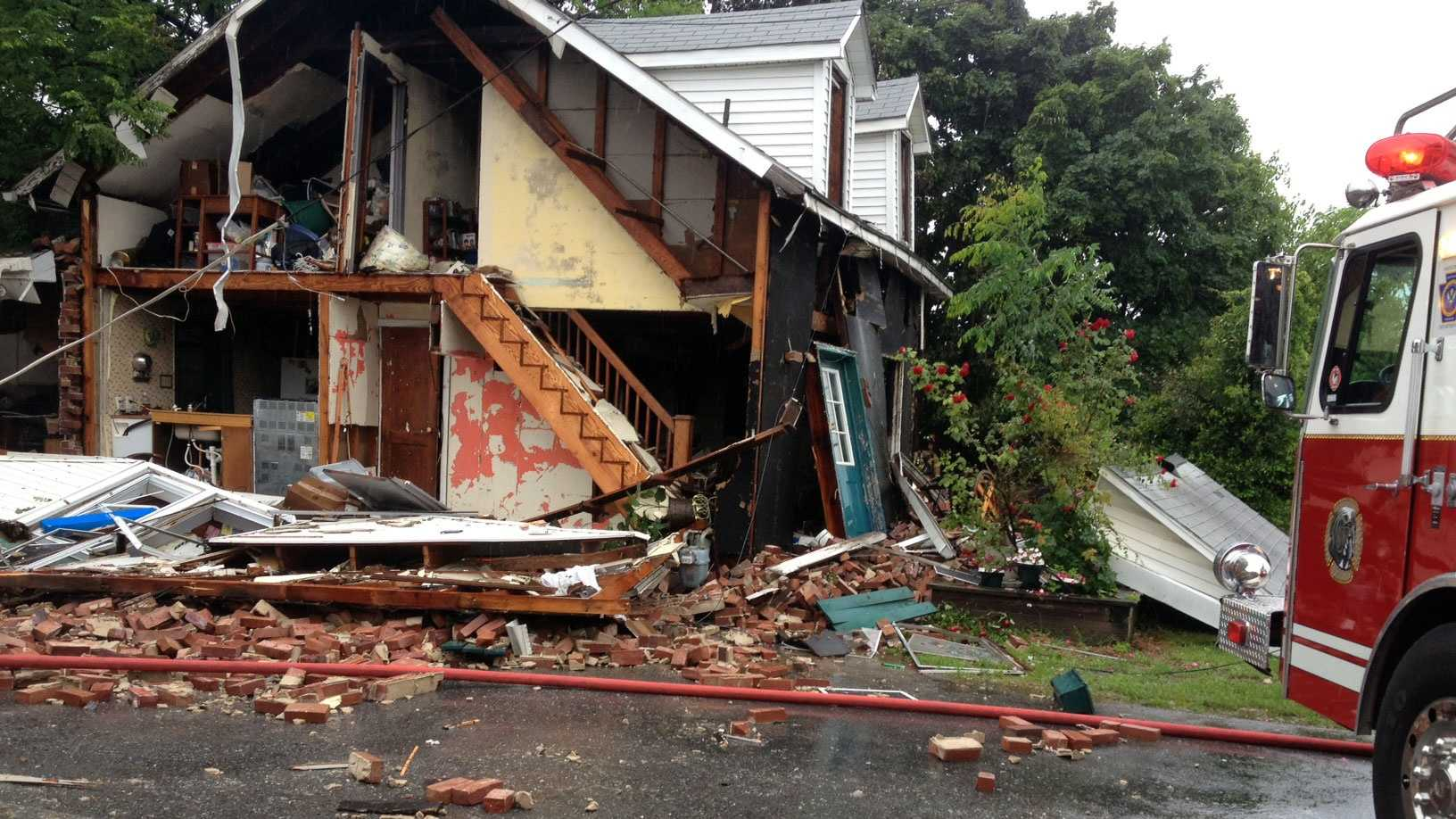 The blast knocked an entire side off the home.