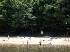 The sand beach at the lake is open from late-May to mid-September from 8 a.m. to sunset.