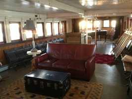 "Ferry Tale: Yankee Ferry, Red Hook, New York. Floating on the Hudson River in the Red Hook area of Brooklyn, this 1907 steel-hulled passenger vessel invites travelers to climb aboard and rest their heads in its spacious quarters. Guests can check out the boat's ""Polka Dot Garden"" that boasts a variety of veggies while enjoying magnificent views of Manhattan. ""This is by far the most unique and amazing place I have ever stayed. It is unlike anything else, blending adventure, history, and a sense of home all in one,"" said a TripAdvisor traveler."