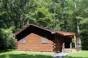 To reserve a cabin, cottage, wooded camping site or yurt, click here.