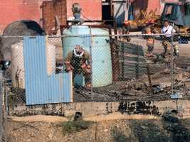 Investigators said a demolition worker cutting up an old oil tank sparked the fire in Spring Garden Township near Richland Avenue and Kings Mill Road.