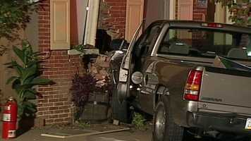 Lancaster police said no one was hurt when a pickup truck smashed into a row home Sunday night at the corner of North Ann and East Marion streets.