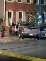 Two men ran away after the truck hit the home, according to Lancaster police.