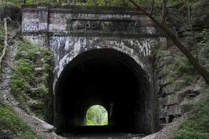 """3. The photographer writes, """"We spent the day in Hocking Hills. Stopping by to show Stella the Moonville Tunnel. We took some pics and look what showed up in mine.. HMMM could it be the Moonville Ghost????? What was interesting was this was the only shot out of several pictures in the same spot. The shot before this one was only 4 seconds before this one, the next shot I was chatting with a hiker and it was about 20 seconds later."""""""