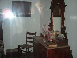 """6. The photographer makes a simple claim with this one - """"There are ghosts at the Whaley House."""""""