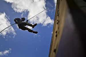 18. A U.S. Army soldier assigned to the 25th Infantry Division Lightning Academy, demonstrates a standard L-Shaped rappel during the May 1, 2013, Lightning Academy Activation Ceremony at Schofield Barracks in Wahiawa, Hawaii. The Lightning Academy is designed to provide a unique, realistic and highly demanding, multilateral, multinational training for 25th Infantry Division soldiers, as well as the other branches of the U.S. Military to include State and Federal agencies, and our international partners in regional security and stability.
