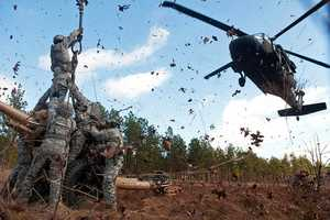25. Artillerymen with the 82nd Airborne Division's 1st Brigade Combat Team prepare to hook up an M119A2 105mm howitzer to a UH60 Black Hawk helicopter during air assault training Feb. 8, 2013, at Fort Bragg, N.C. The artillerymen are assigned to 3rd Battalion, 319th Airborne Field Artillery Regiment.