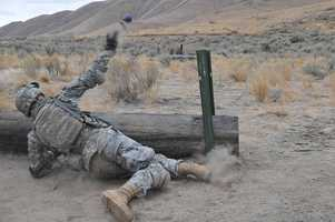 36. A Soldier from 2nd Squadron, 14th Cavalry Regiment, 2nd Stryker Brigade Combat Team, 25th Infantry Division, tosses a training grenade from behind cover during hand grenade training on Oct. 14 at Yakima Training Center, Wash. The cavalry troopers, from Schofield Barracks, Hawaii, deployed to Yakima Training Center to conduct tough, realistic training over the rugged, mountainous terrain in Washington state.
