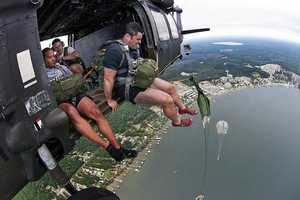 38. A paratrooper with the 95th Civil Affairs Brigade exits a UH60 Black Hawk helicopter Sept. 19, 2012, above White Lake near Elizabethtown, N.C. He and fellow paratroopers were practicing water jumps.