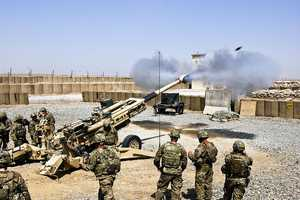 45. Paratroopers with A Battery, 4th Battalion, 319th Airborne Field Artillery Regiment, 173rd Airborne Brigade Combat Team, fire an M777A2 cannon during a firing demonstration for visiting Command Sgt. Maj. William Johnson, the command sergeant major for ISAF Joint Command, July 12. The Sky soldiers of the 173rd are on their 4th deployment to Afghanistan in support of Operation Enduring Freedom.
