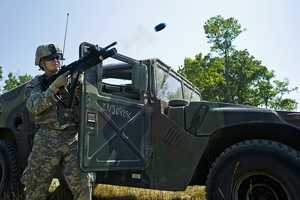 47. Military Policeman Spc. William McMillan, 81st Troop Command, fires an M203 grenade launcher at Camp Atterbury, Ind., June 21, 2012.
