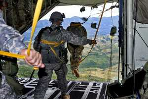 48. Competitors conduct a static line jump from a C-130 aircraft during Fuerzas Comando 2012 at the Colombian National Training Center on Fort Tolemaida, June 13, 2012. Fuerzas Comando, established in 2004, is a U.S. Southern Command-sponsored special forces skills competition and senior leader seminar which is conducted annually. This event is aimed at enhancing training and strengthening regional and multinational cooperation, mutual trust, readiness and interoperability of special operations forces in the region. Special Operations Command South serves as the U.S. execution agent for the exercise.