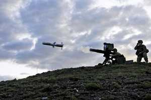 3. 1st Lt. Jordan Farrar, 2nd Battalion, 506th Infantry Regiment, 4th Brigade Combat Team, 101 ABN DIV, fires a tube-launched, optically-tracked and wire-guided missile at a target while Cpl. Christopher Parker, observes at the heavy weapons range on Forward Operating Base Salerno in Afghanistan, Aug. 14, 2013.