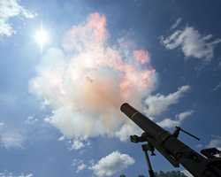8. A 120mm mortar leaves the tube, fired by Soldiers of Headquarters and Headquarters Company, 1st Battalion, 293rd Infantry Regiment headquartered in Fort Wayne, Ind., fire 120mm mortars at Camp Atterbury, Ind., July 13.