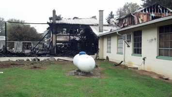 Several propane tanks inside the building exploded, but this one was spared.