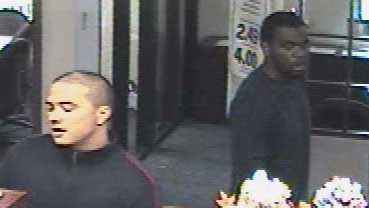 Police released this surveillance photo of the bank robbery suspects.