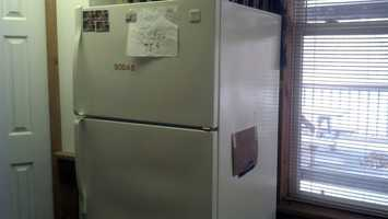 Club leaders think Davis ate cheese from this refrigerator.
