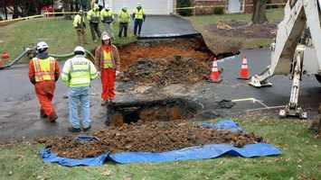 Emmalynn Conner, whose driveway was swallowed by the sinkhole, told News 8 there was a sinkhole in the same spot 15 years ago. She said a neighbor across the street had a sinkhole in their yard last summer.