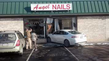 The driver told firefighters she lost control on ice in the parking lot and drove into the nail salon. Neither woman was hurt.