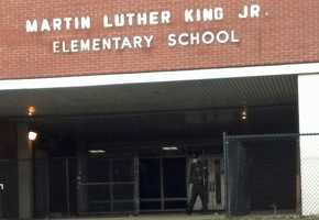 """""""An anonymous caller related that two males had been in the playground area of the school. They were described as black males, one wearing a red sweatshirt, the other in a black sweatshirt. No further description was provided. One of the males fired a single shot from a handgun,"""" a police news release stated."""