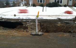 On Friday morning, crews were out working to repair the water main and hole.
