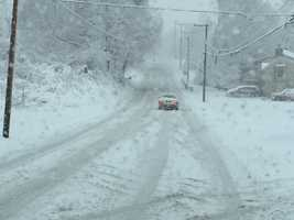 Cars struggle to climb Spring Wood road in York Township, York County, 9:20 a.m. Monday.