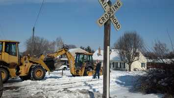 A slow-moving train collided with a backhoe just after 10 a.m. Monday in East Cocalico Township, Lancaster County, on Wabash Road.