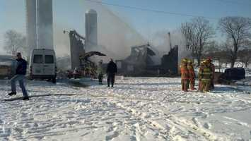 A large fire that started with an explosion sent one man to the hospital on Tuesday.
