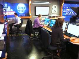 And here's the News 8 Storm Team hard at work in the indoor studio at the same time.