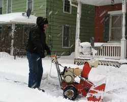 Snow-blowing on State Street in Quarryville, 8:20 a.m. Thursday.