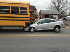 The bus was fully loaded with students, but no one on the bus or in the car was hurt.