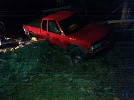 A York County man is accused a carjacking a vehicle Monday night in the parking lot of Central York Middle School after crashing this red pickup truck. Neighbors say the vehicle drove erratically along Ridgewood Road.