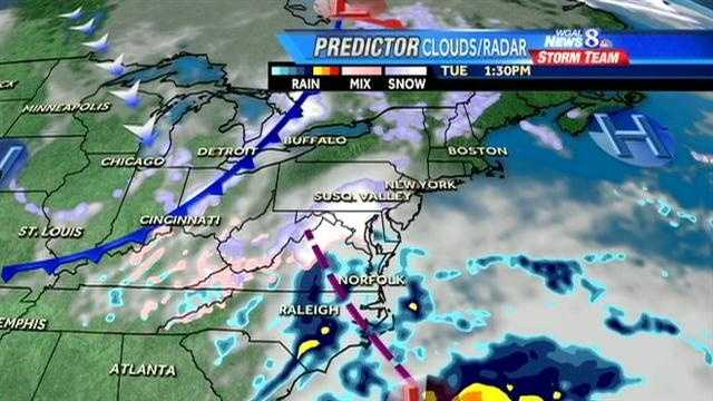 These graphics show computer projections for the snow showers. The hazy white areas represent cloud cover. Solid white and purple are snow. Pink is wintry mix. Blue is rain. The day and time are noted in the upper right.