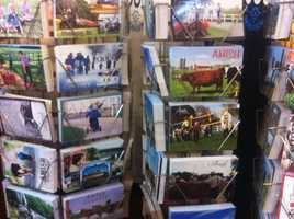 Tourists can pickup postcards that feature scenes of Pennsylvania Dutch Country.