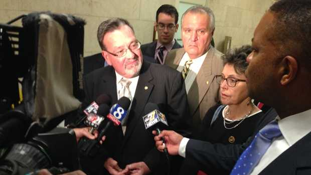 Democratic state Rep. Michael O'Brien talks to the media after Democrats walk out of a hearing about calling for the impeachment of Pa. Attorney General Kathleen Kane.