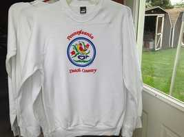 """This sweatshirt is decorated with a hex symbol and the phrase """"Pennsylvania Dutch Country."""""""
