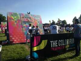 At the event, more than 10,000 runners were hit with colored corn starch as they ran or walked.